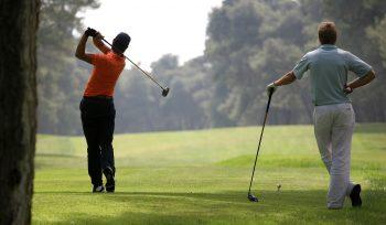 golfers swinging